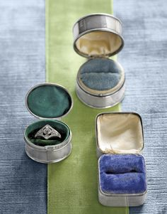 Silver ring boxes with colorful velvet ring pads. You can find these vintage beauties on Ebay from time to time. They are incredible and add the most personal touch to your vintage wedding ring.
