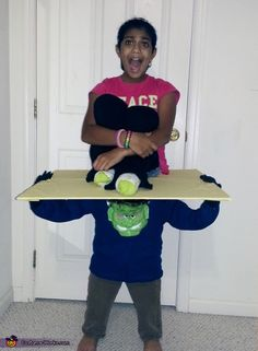 Nina: This is an optical illusion costume. We named it Frankenstein's bounty because it looks like a mini Frankenstein is carrying her away. So what do you think - is she...