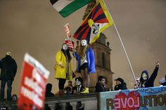 Brandishing flags and placards, protesters met in Trafalgar Square ahead of the march thro...