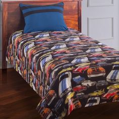 Bring the auto show to your son's bedroom with the Kathy Ireland Home by Hallmart Collectibles Street Rods Comforter Set. Featuring cars of every color atop a black background this colorful bed set is the perfect pattern for your growing boy. Get him ready to drive off to a good night's sleep with this durable comfortable ensemble that will last for years.Comforter DimensionsTwin: 86L x 68W inchesFull: 86L x 86W inchesBedding Set Components:Twin: