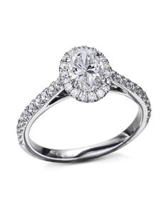 Platinum engagement ring mounting French-set with round brilliant cut diamonds around the center stone and of the way around the band. Oval Diamond, Diamond Bands, Diamond Cuts, Halo Diamond Engagement Ring, Quality Diamonds, Brilliant Diamond, French, Stone, Rock