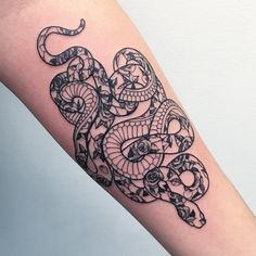 Floral snake tattoo