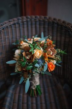 Rose and thistle autumn wedding bouquet. Photography by http://jenowensimages.com/