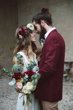 Match the groom's wine-colored jacket to the bride's florals by scattering in similarly shaded pieces into the bouquet, such as roses or dahlias.