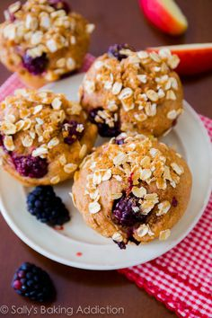 Sky High Blackberry Apple Muffins. Bursting with juicy fruits and topped with a simple streusel. Surprisingly healthy!