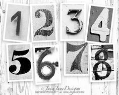 table numbers... so awesome!  take pictures of random numbers and print in black & white with white border!  love it.