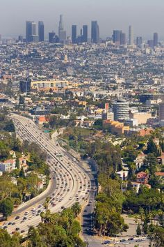 Downtown Los Angeles -- view from the Hollywood Hills (or at least above them).  Home of LA Opera, LA Phil, Cathedral of Our Lady of the Angels, LATC... lots of good arts!
