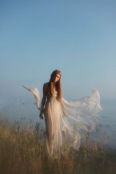 Fairy dress, beautiful photo. If I had ever had a beach wedding this is what I would have wanted.