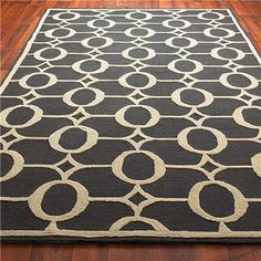Graphite and cream indoor/outdoor rug. Perhaps for the family room, nice and toddler-resistant.