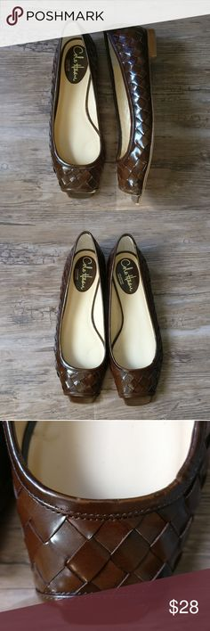 Cole Haan Deep Brown Peep Toe Weaved Flats These shoes are new but you will find some flaws along them. Please see pictures of upclose detail. You'll find some discoloration and some scratches due to being piled up with other shoes. Cole Haan Shoes Flats & Loafers