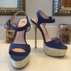 Shoedazzle Madison Vanita Platform High!  Shoedazzle Madison Vanita heels.   Faux  cork heel and platform.   Light blue snakeskin pattern straps.   6 inch heel with 1 1/2 inch platform.   EUC! Shoe Dazzle Shoes Heels