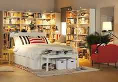 awesome ikea bedroom. Love how the white brimmes bed is sourrounded by books. ikea brimnes bed with storage
