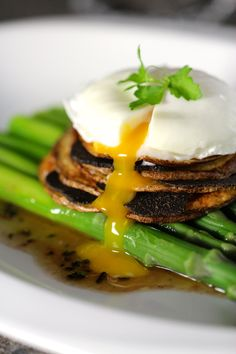 Truffled Poached Egg, Asparagus & Truffle Vinaigrette, Black Truffle & Potato Stack