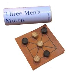 Three Men's Morris is a simple strategy game for two players. It was known t… - Modern Board Games For Couples, Games For Kids, Games To Play, Yard Yahtzee, Diy Cadeau Noel, Medieval Games, Virtual Games, Childhood Games, Game Theory