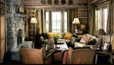 Cozy and comfy log home living room in Montana.....love the collection of old western hats as a decoration