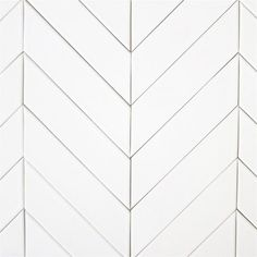 A few months ago, I came across a photo of a friend that had installed a skinny and long white tile in a herringbone pattern on their kit...