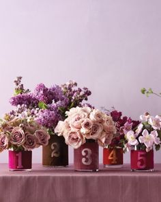 Velvet table numbers wrapped around vases