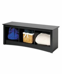 Cubbie bench. Perfect for storing throw blankets. Put a fun cushion on top for color