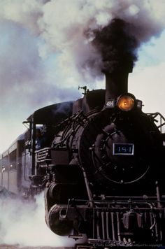 Image detail for -Black steam engine emerging from clouds of steam