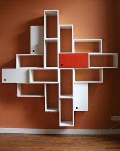 Symmetric designed bookcase with 16 squares. €1.620,00, via Etsy.