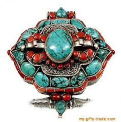 Google Image Result for http://www.gd-wholesale.com/userimg/47/2487i1/tibetan-turquoise-red-coral-amulet-jewelry-8.jpg