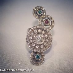 This magnificent ring is made from White Gold, Blue, Pink & White Diamonds.