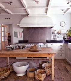 country kitchen with stainless steel range guard with decorative riveted border
