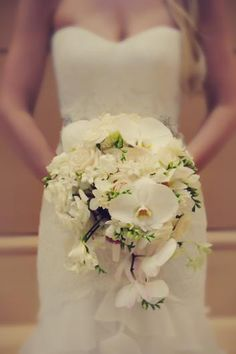 gorgeous all white cascading bridal bouquet; day lillies, dendrobium orchids, roses, stephanotis