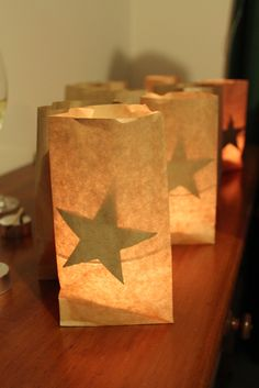 Put tea light candles in small glasses, then place inside kraft bags with cut out stars attached on the inside.
