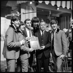 THE ED SULLIVAN SHOW February, 16, 1964. The Beatles are presented with a plaque conferring on them the honor of membership into a local college fraternity. The Beatles' second appearance. Deauville Hotel, Miami Beach, Florida. (Photo by CBS via Getty Images)
