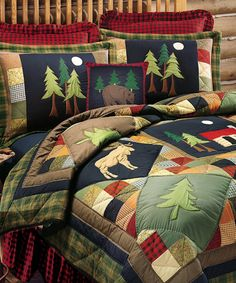 Timberline Rustic Quilt Bedding Colorful and cozy, the handcrafted Timberline Rustic Quilt Bedding Collection features pine tree, cabin, bear, moose and deer appliques among a patchwork of rustic plaid, floral, checked and solid fabrics. Quilts and shams are made from cotton with poly fill and are machine washable. The Timberline Quilt Bedding Collection is available in