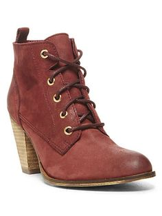 """Rock a pair of lace-up ankle boots with your knee socks to elongate your legs! A slightly pointed toe and a small, stacked heel will also help to create a long, lean silhouette."" Pennylne Bootie, $104.98, Steve Madden   - Seventeen.com"