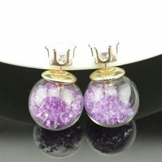 Double Sided Earrings Purple Crystals I have more then one. Please don't buy this listing. When you are ready to purchase ask me to set you up a listing.   Double Sided Earrings  $9.00 for 1 pair  $8.00 each for 2-3 pairs  $7.00 each for 4-5 pairs  $6.00 each for 6+ pairs   No Other Discounts Apply!  Double Sided Earrings Jewelry