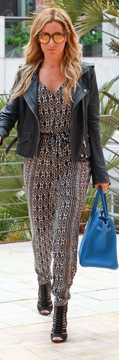 Who made  Ashley Tisdale's blue tote handbag, black leather jacket, print jumpsuit, and black shoes that she wore in Beverly Hills on May 22, 2014?