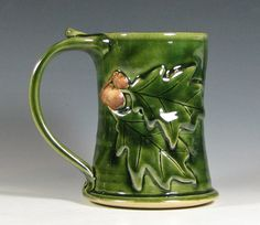 Acorn and oak leaf ceramic stein from Etsy - I think it makes a great vase