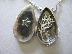 Gorgeous hand crafted solid silver locket with a stunning labradorite teardrop stone. http://www.shop.obsidianart.co.uk/collections/jesa-marshall/products/labradorite-silver-moongazing-hare-locket-jesa-marshall