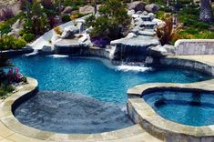 San Diego pool with integrated water slide and cascading waterfall