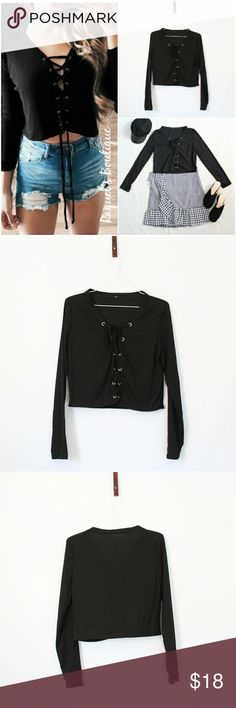 Danni Tie Up Top in Black Details: Ribbed lace-up front long sleeve top, semi-cropped  Brand: Boutique Brand  Size: Medium Measurements: Bust/34 inches Length/17 inches  Size: Large Measurements: Bust/36 inches Length/17.5 inches  Condition: New and packaged with boutique tags Tops
