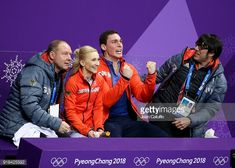 Aljona Savchenko and Bruno Massot of Germany surrounded by coaches Alexander Konig and Jean-Francois Ballester react at 'kiss and cry' during the Figure Skating Pair Skating Free Program on day six...