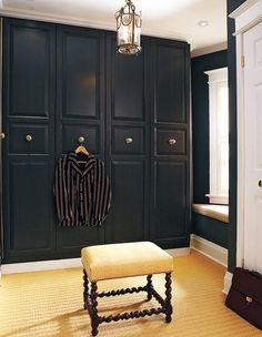 IKEA hacks: Designer Tommy Smythe updated his PAX doors with molding and vintage knobs. Combined with the sleek black paint, this new storage looks high-end and beautiful.
