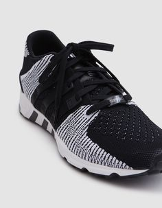 Modern runner from Adidas in Core Black. Primeknit upper. Sock-like construction. Lace-up front with flat woven laces. Grosgrain '3 Stripes' at sides. TPU heel cage and support piece. OrthoLite® sockliner. Logo detailing at tongue.
