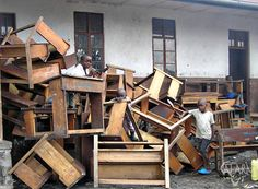 Desks removed from a local school in Goma, D.R. Congo so displaced people have a place to sleep at night.