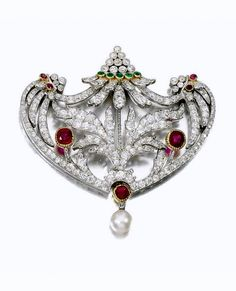 Natural pearl, gem set and diamond brooch-pendant, Early 20th Century. Of open work foliate design set with cushion-shaped rubies, circular-cut emeralds, circular-cut and rose diamonds, suspending a natural pearl drop.