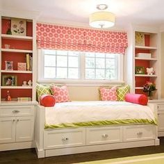 Fantastic pink and green girl's bedroom with built-in cabinetry and daybed with trundle around window. Description from decorpad.com. I searched for this on bing.com/images