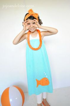 How to make a towel wrap... Such a cute kids Summer beach towel. jojoandeloise.com