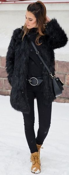 Black faux Fur Coat, Black Turtleneck, Statement Belt, Black Skinny Jeans, Camel Lace Up Booties | total Black With Pop Of Camel Winter Street Style | Choice by Anna
