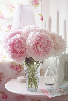 Peonies are a favorite. Fluffy pink blooms in Spring. Love these!
