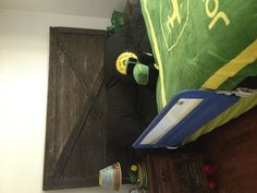 Kalins John Deere room and new headboard made from our old barn door! I have one happy little boy!