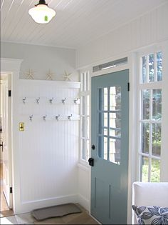 more hooks....but with paneling! small functional laundry + mud room ideas and inspiration