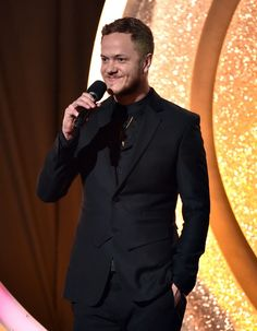 Dan Reynolds of Imagine Dragons speaks onstage during the 2014 iHeartRadio Music Awards